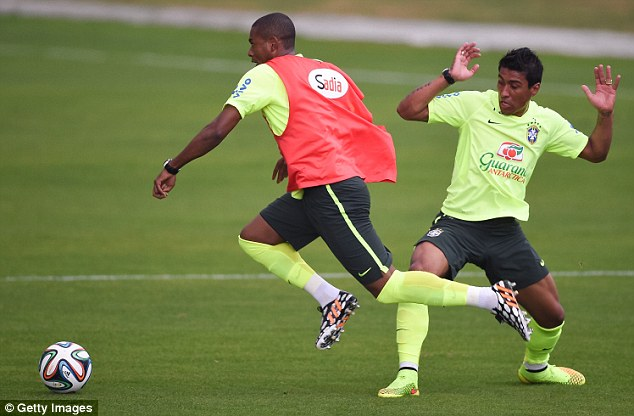 Careful: Paulinho (right) and Fernandinho take part during a training session