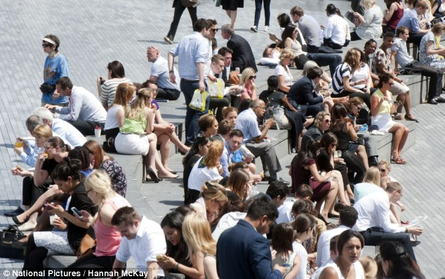 Don't get used to it: Londoners were enjoying the sun near to Tower Bridge on Monday, but the hot weather is not likely to last, says Met Office