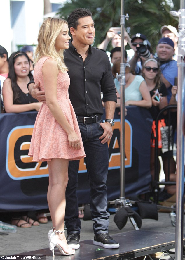 Bride-to-be: Conrad, seen here with Extra! host Mario Lopez, is in the process of planning her autumn nuptials to musician and recent USC law school graduate William Tell, 34