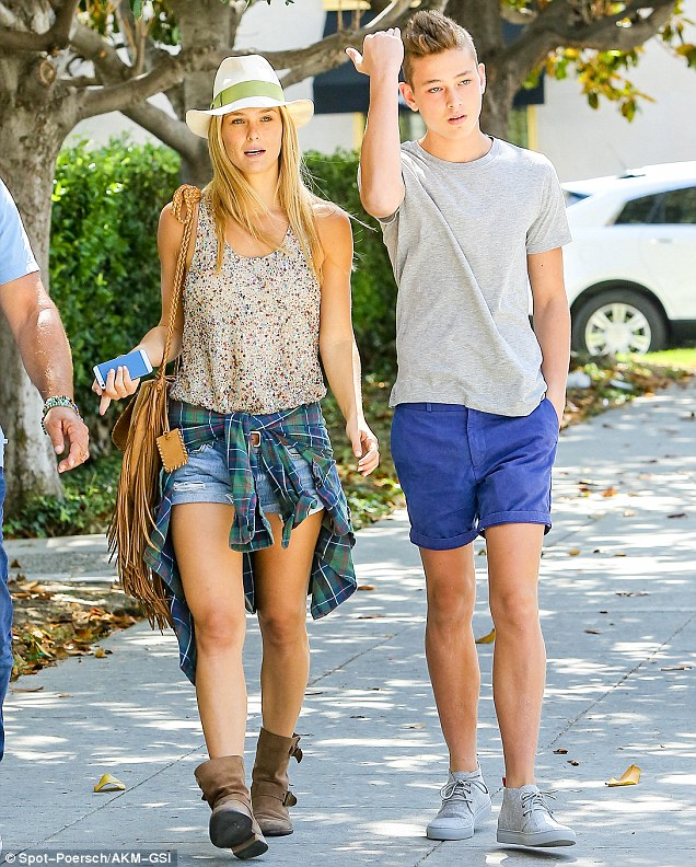 Beverly Hills, CA - Israeli babe Bar Refaeli spent her afternoon with her dad Rafael and her little brother getting some retail therapy done, the trio visited Saks Fifth Avenue and Barneys New York, the blonde fashion model wore a patterned colored top, denim shorts with a plaid shirt wrapped around her waist and brown leather suede booties. AKM-GSI          June  9, 2014 To License These Photos, Please Contact : Steve Ginsburg (310) 505-8447 (323) 423-9397 steve@akmgsi.com sales@akmgsi.com or Maria Buda (917) 242-1505 mbuda@akmgsi.com ginsburgspalyinc@gmail.com