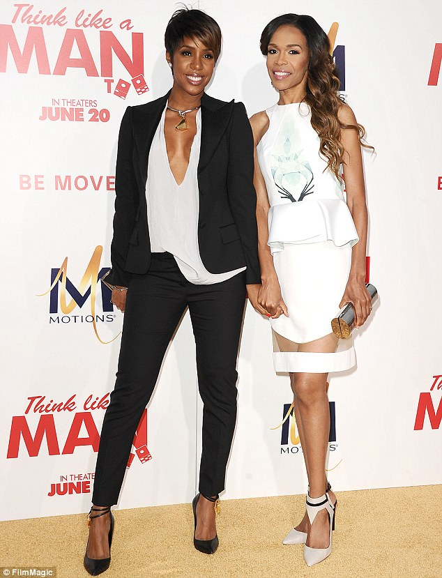 BFF: Kelly Rowland and Michelle Williams held hands at the Think Like A Man Too premiere at the TCL Chinese Theatre in Hollywood on Monday