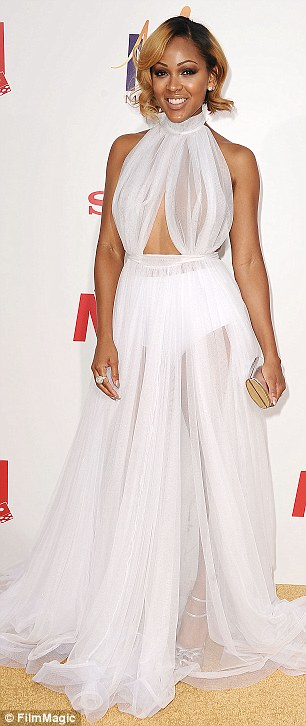 Going with the flow: Actress Meagan Good wore a sheer white gown while actress LaLa Anthony showed off her cleavage and legs in a black gown