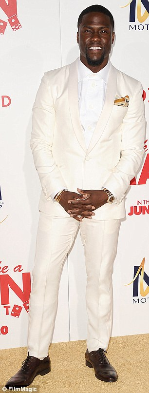 Contrast: Michael Ealy rocked a sleek midnight blue suit while actor Kevin Hart opted for all white