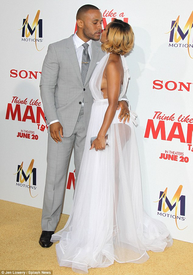 PDA: Meagan smooched her husband, DeVon Franklin, who is Columbia Pictures' SVP of production