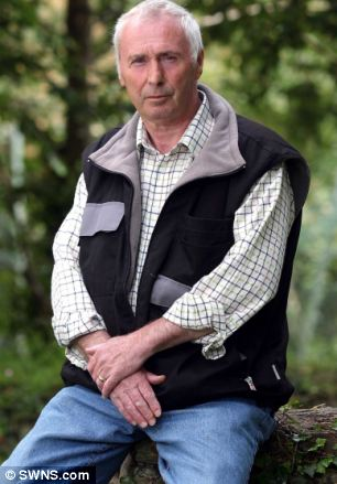 Stunned: Glenn Buscombe, 60, was attended to by paramedics after suffering agonising pain in his leg