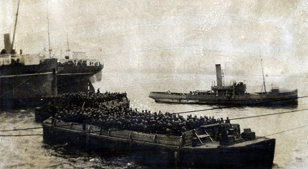Troops going to land at Gallipoli on barges. The barges were later used as water storage tanks on the beaches