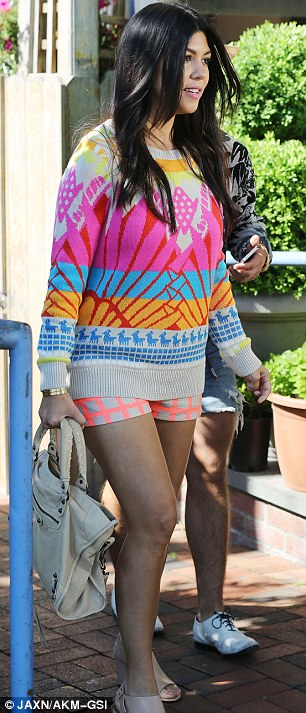 Colorful ensemble: Kourtney donned a bright sweater and short shorts at the restaurant in The Hamptons