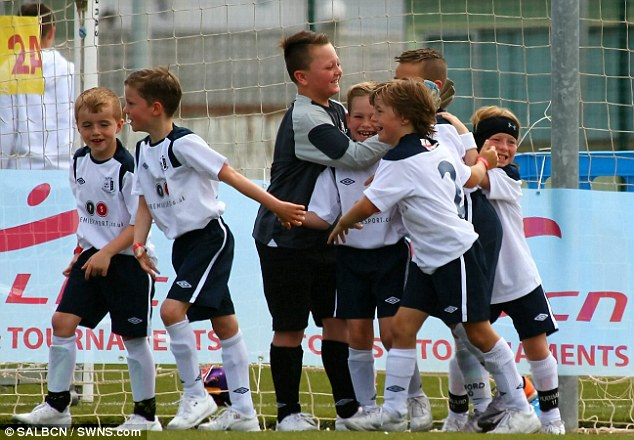 Jubilant: The Upminster Park Rovers Under Eight's won the Barcelona Football Festival final