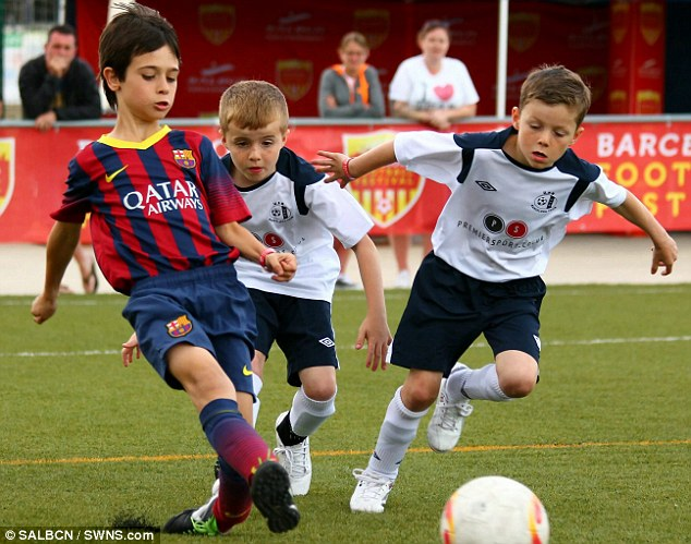 Winners: The British team triumphed 2-1 to against the Barcelona youth team