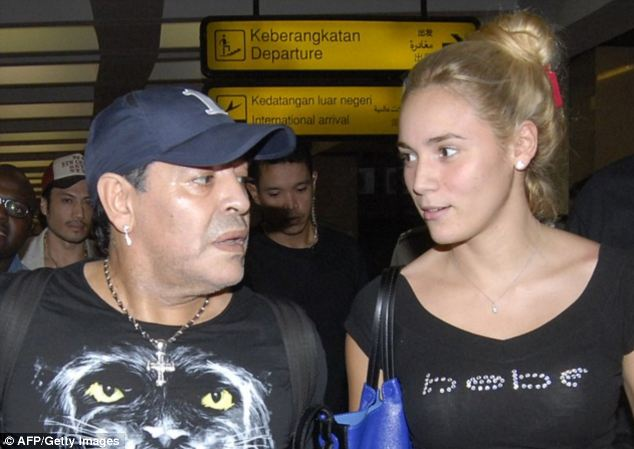 Argentinian football star Diego Maradona has asked a judge to order his ex-girlfriend Rocio Oliva's detention. The pair are pictured together here in June last year