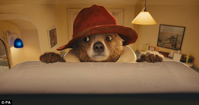 Not just for children: The marmalade-loving creature retains his familiar duffel coat and floppy hat in the movie - called Paddington - to be released in November