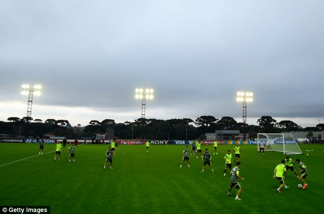 Base: Under an ominous looking rainclouds, Spanish players train at their World Cup base in flood-hit Curitiba