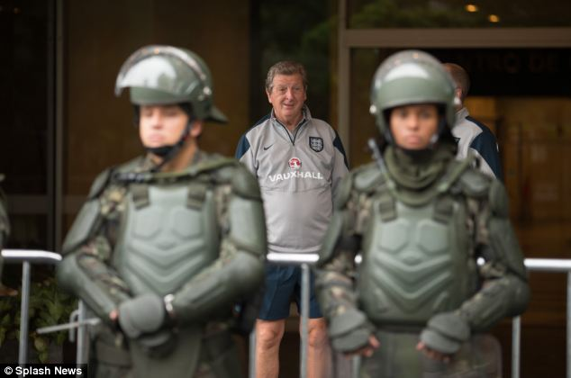 Under protection: England manager Roy Hodgson heads to training, complete with the team's military escort