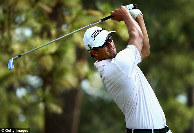 In the frame: Australian Adam Scott, pictured during a practice round at Pinehurst, should be in contention come Sunday