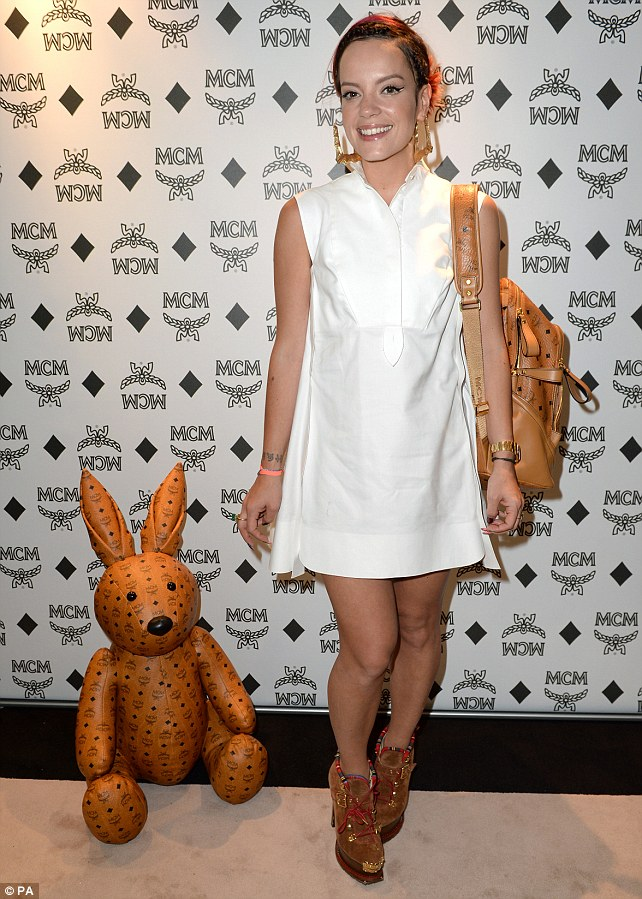 Bags of style: Lily matched her tan rucksack to her chunky boot style suede heels