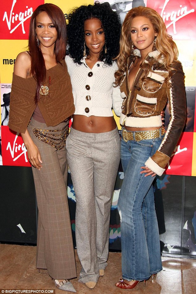 Friends forever: Perhaps bandmates Michelle and Beyonce, who Kelly is seen with in 2004, will be godmothers