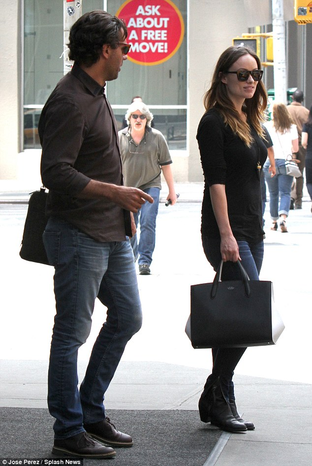 Looking good: The actress teamed a snug black top with a figure-hugging pair of jeans