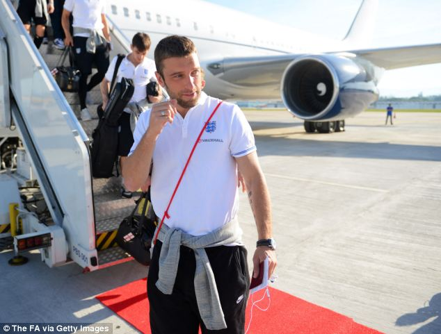 The father of Rickie Lambert, pictured arriving in Brazil ahead of the World Cup, has been fired from his warehouse job, it has been revealed