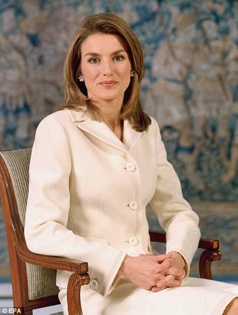 Beautiful: Although the then 32-year-old Princess Letizia looks lovely, the outfit she wore for her first royal portrait was ageing