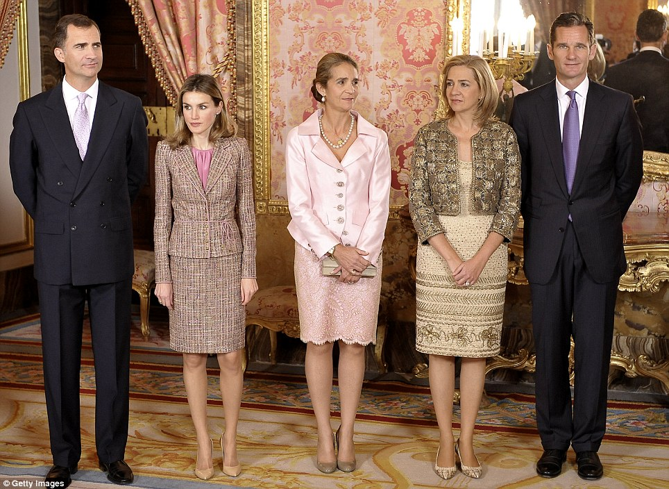 Chic: Princess Letizia is glamorous in a tweed two-piece in this royal family photo with Infanta Elena, Infanta Cristina and Iñaki Urdangarin, Duke of Palma de Mallorca