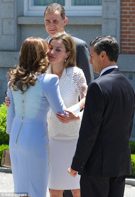 Assured: Letizia pictured greeting Angelica Rivera, the wife of Mexico's president in Madrid today