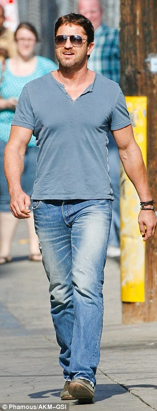 Cool, calm and casual! Earlier in the day Gerard showed off his muscles in a tight blue T-shirt and denim jeans