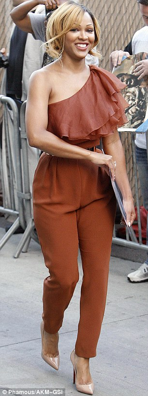 Work it, girl! Meagan's honeycomb locks perfectly complemented her camel jumpsuit as she strutted through the crowd of adoring fans