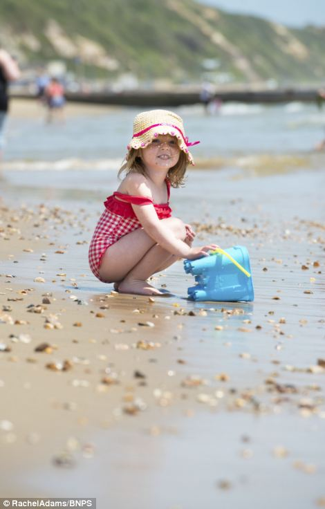 Fun for all ages: Sophie Chivers, four, from Southampton enjoys the heatwave on Bournemouth beach as the sun beats down
