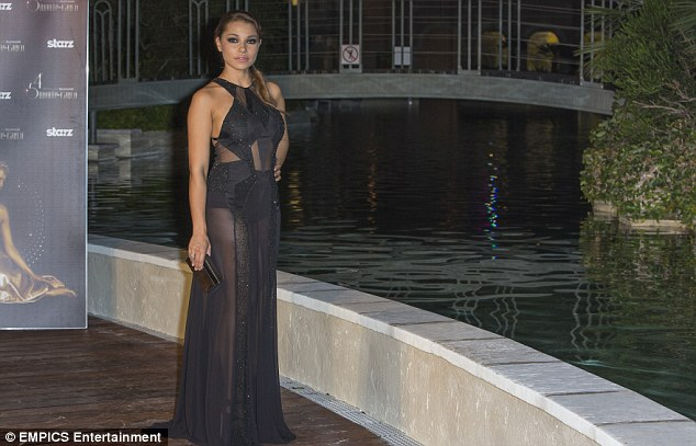 Wow: The 29-year-old brunette's underwear was visible beneath her sheer dress