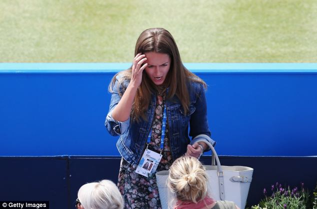Prime position: Kim seemed keen to get to her seat for her boyfriend's first match under the tutelage of former Wimbledon champion Ms Mauresmo