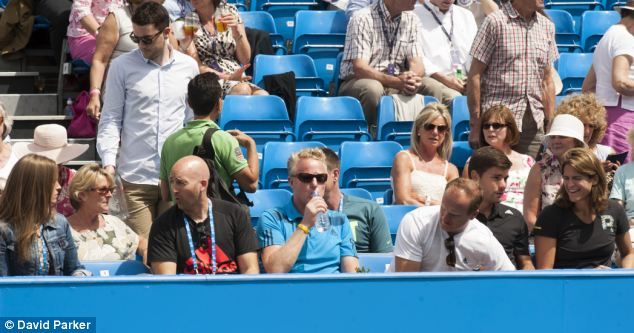 Seating plan: Kim was seated a few seats down from Murray's new coach as she watched his match from the front row at Queen's