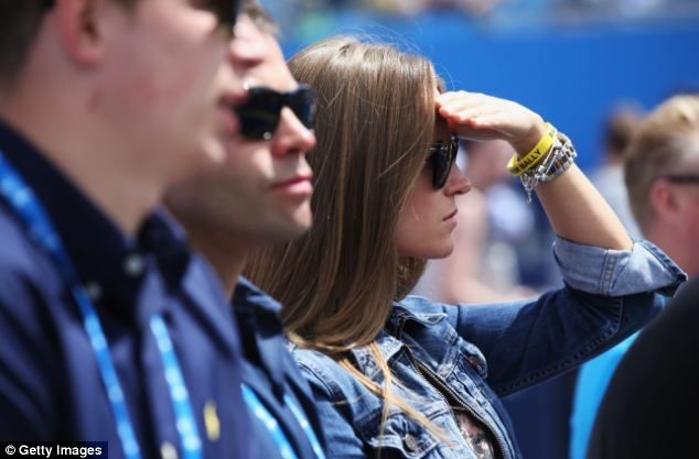 Viewpoint: Kim shielded her eyes from the June sunshine with a pair of sunglasses, and also sported a 'Rally For Bally' bracelet in memory of Elena Baltacha, who died last month