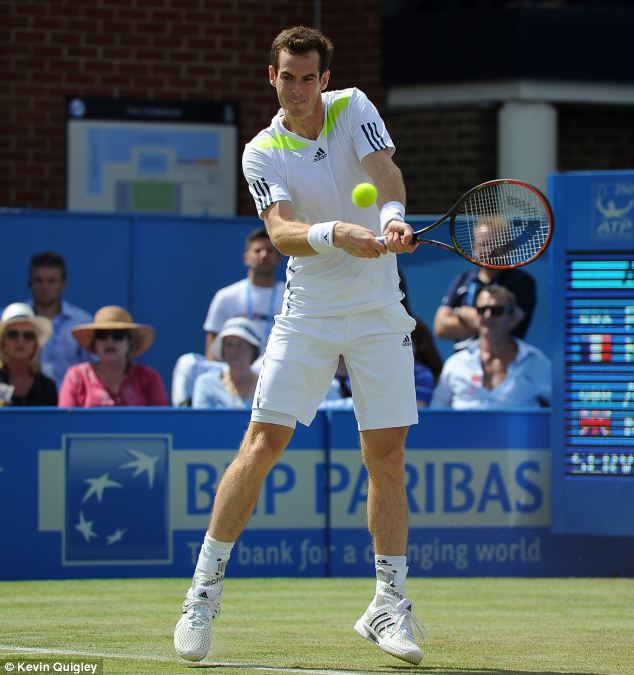 In action: Murray won his match against Mathieu with a comfortable 6-4 6-4 victory, as he returned to action on a grass court ahead of Wimbledon later this month