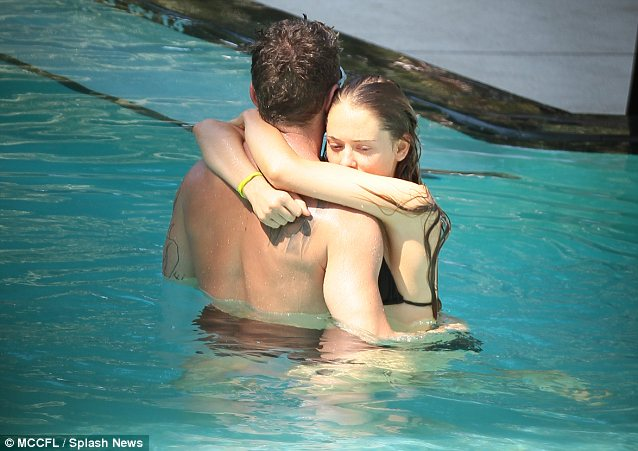 Romantic getaway: The couple are currently enjoying a romantic break together in Miami and can barely keep their hands off each other
