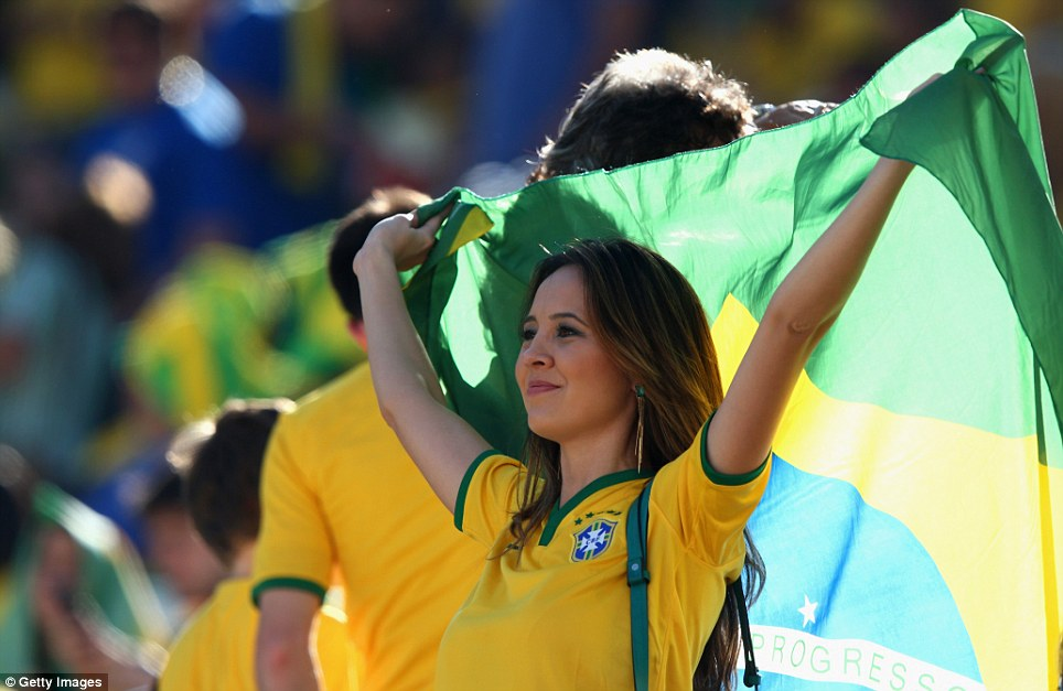 Proud: A female Brazil fan shows off her colours at the Opening Ceremony of the 2014 World Cup ahead of the Brazil and Croatia clash in Sao Paulo
