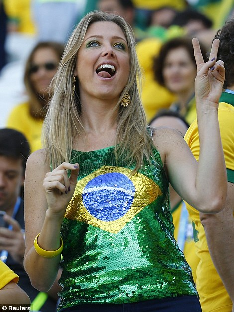 Peace: A Brazil fan certainly looks the part in Sao Paulo as she watched the opening ceremony