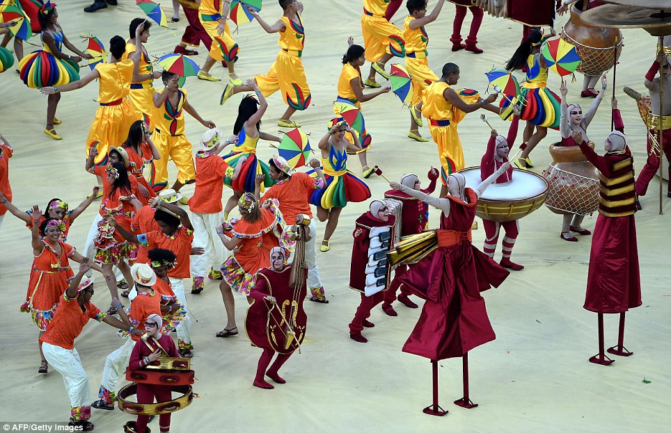 Performers take part in the opening ceremony of the 2014 FIFA World Cup at the Corinthians Arena in Sao Paulo