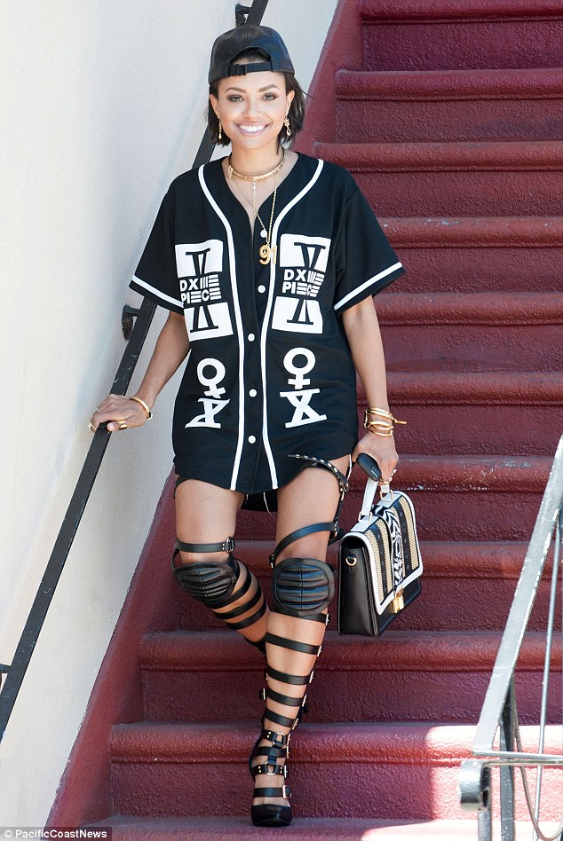 Needs a word with her stylist: Kat Graham flashed a smile as she walked downstairs in a strappy pair of gladiator heels in West Hollywood on Wednesday