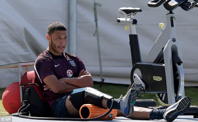 Fitness fight: Alex Oxlade-Chamberlain is battling back after picking up an injury in the draw with Ecuador