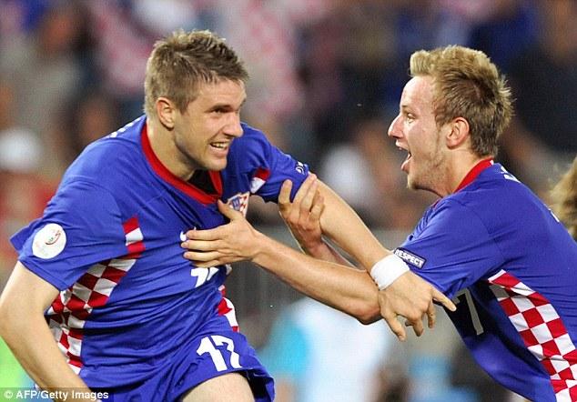 Dynamic duo: Ivan Rakitic (right) will partner Modric in midfielder and the pair are full of creativity