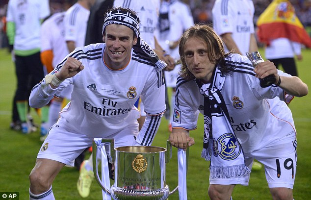 Champions: Modric (right) inspired Real to the Champions League and Rakitic Sevilla to Europa League glory