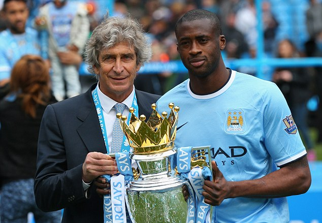 Missing piece: City manager Manuel Pellegrini (left) thinks Fernando can slot perfectly into his midfield