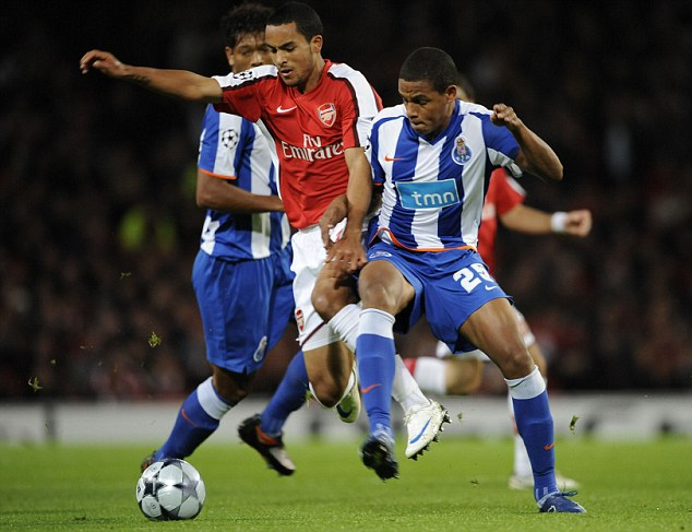 Combative: Fernando (right) challenges Theo Walcott during a Champions League match