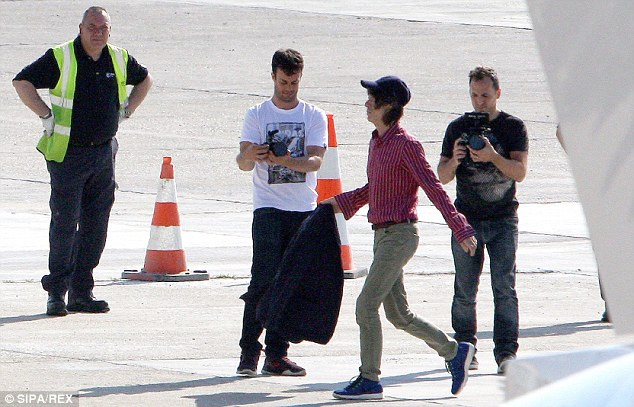 Touching down: Sir Mick Jagger (second right) and his Rolling Stones bandmates are ready to rock Paris, after touching down in the French capital on Wednesday ahead of their highly anticipated show