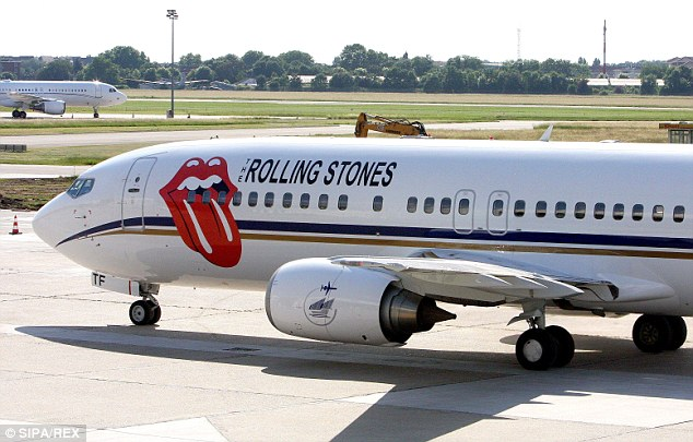 High flyers: The group have been travelling on their own Rolling Stones-branded jet
