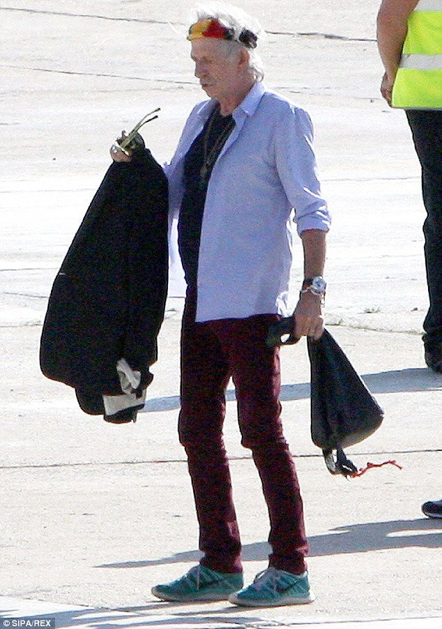 Nice headband: Keith Richards arrived in an unbuttoned blue shirt over a black T-shirt and maroon jeans