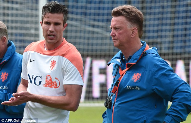 Familiar: Van Persie and Dutch manager Louis van Gaal (right) will work together at Manchester United too