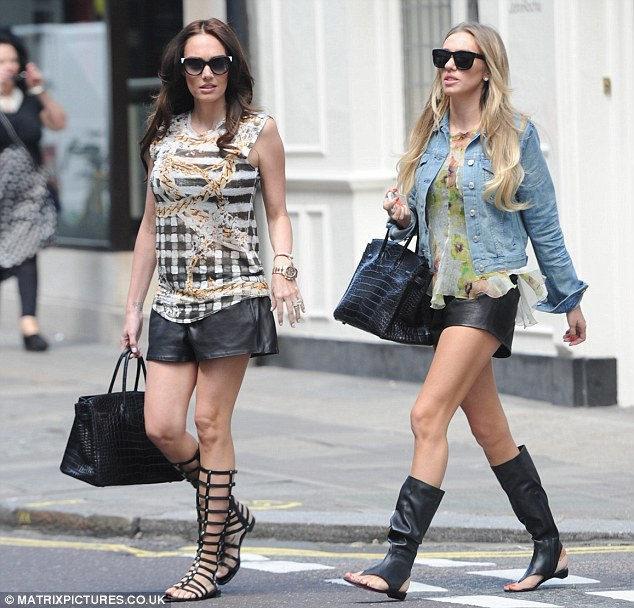 Great minds...: Tamara Ecclestone headed out for lunch with sister Petra Stunt at London's Arts Club on Thursday in very similar attire