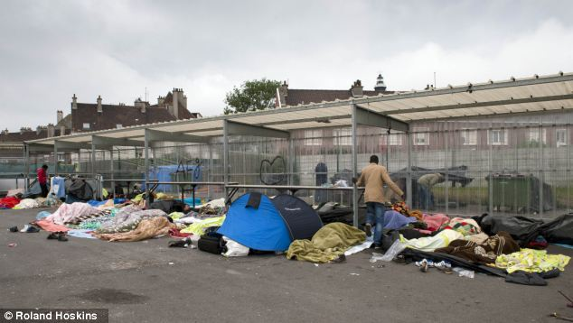 Migrants in the French port of Calais have gone on hunger strike demanding to be let into Britain. Pictured is the remains of a camp in Calais where migrants were told to get out of the centre of or face arrest last month