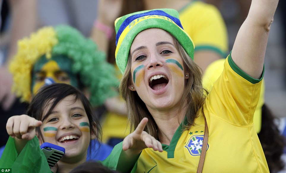 Fans cheer before the start of the first Group A match between Brazil and Croatia, as the opening ceremony seemed to get them in the mood
